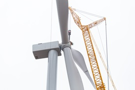 Close-up of windmill with crane